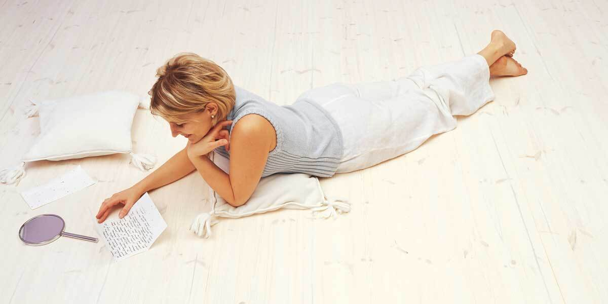 woman lying on the wood floor